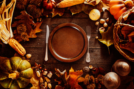 Photo for Thanksgiving dinner. Autumn fruit with plate and cutlery. Thanksgiving autumn background - Royalty Free Image