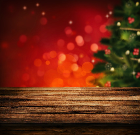 Photo for Christmas holiday background with empty wooden deck table over Christmas tree. Empty display for montage. Rustic vintage Xmas background. - Royalty Free Image