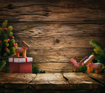 Foto de Christmas background. Empty table for your montage. Xmass tree on wood. Space for text - Imagen libre de derechos