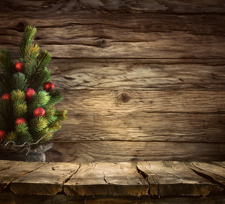 Photo pour Christmas background. Empty table for your montage. Xmass tree on wood. Space for text - image libre de droit