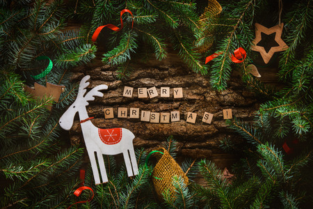 Foto de Merry Christmas. Christmas greeting card with rustic wood and ornaments. Xmas backgroud. - Imagen libre de derechos
