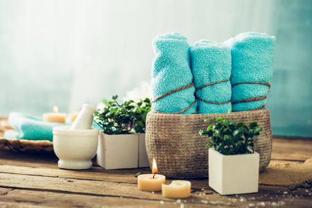 Photo for Spa and wellness setting with flowers and towels. Dayspa nature products - Royalty Free Image