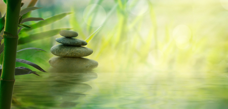 Foto de Spa and wellness. Natural massage stones  with bamboo. Spa  oriental background - Imagen libre de derechos