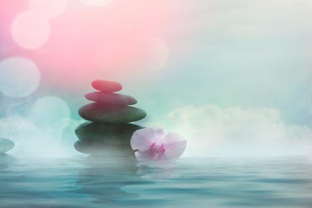 Foto de Spa and wellness. Natural massage stones  with orchid flower .Spa treatment - Imagen libre de derechos