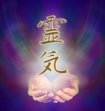 Photo for Healers cupped hands and Reiki Kanji Symbol on misty background - Royalty Free Image