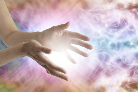 Photo for Female healing hands and vibrant energy field - Royalty Free Image