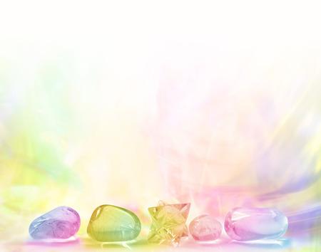 Foto de Row of Rainbow Healing Crystals on a pastel gradient rainbow colored background - Imagen libre de derechos