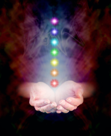 Foto de Seven Chakras floating in Healing Hands - Imagen libre de derechos