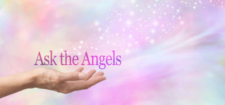 Photo for Ask the Angels for Help  Female hand face up with the words Ask the Angels floating above on a  misty pastel bokeh background and a stream of sparkles flowing from the hand - Royalty Free Image