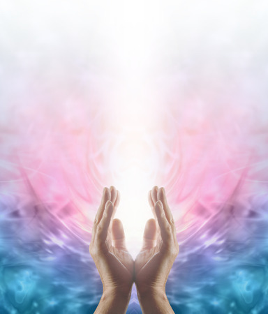 Foto de Beaming Reiki Healing Energy  Male parallel hands facing upwards with a beam of bright white energy flowing up on a pink and blue ethereal energy formation background - Imagen libre de derechos