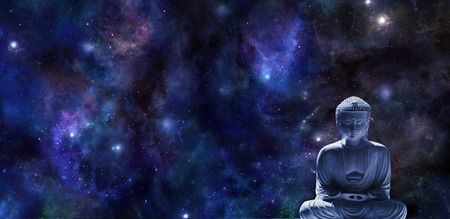 Foto de Mindfulness Meditation Banner -  wide dark blue night sky background with planets and stars and a statue of Buddha in lotus position in bottom right corner with plenty of copy space - Imagen libre de derechos