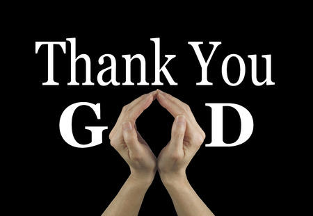 Foto de Thank You God - female hands making an 'O' shape in the word GOD on a black background with Thank You above - Imagen libre de derechos
