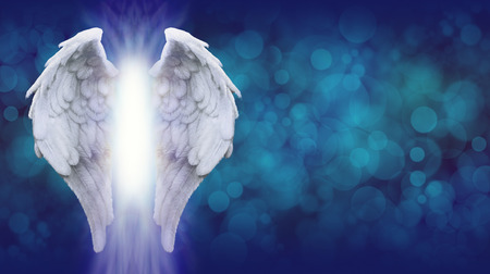 Photo for Angel Wings on Blue Bokeh Banner    - Wide blue bokeh background with a large pair of Angel Wings on the left side and a shaft of bright light between - Royalty Free Image