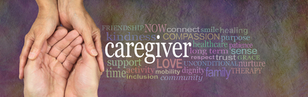 Foto de Caregivers Word Cloud - female hands gently cupped around male cupped hands beside a CAREGIVER word cloud on a rustic stone background - Imagen libre de derechos