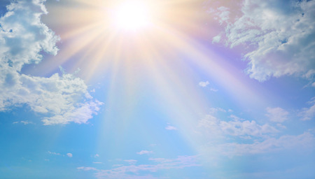 Photo for Miraculous Heavenly Light -  Blue sky, fluffy clouds and a beautiful warm orange yellow sun beaming down radiating depicting a holy entity - Royalty Free Image