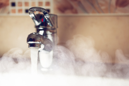 Photo for water tap with hot water steam - Royalty Free Image