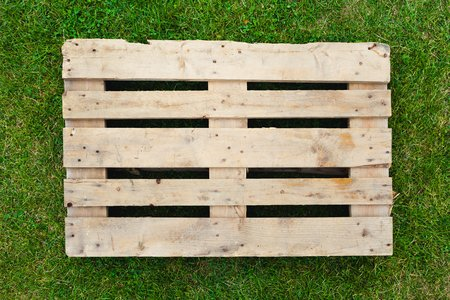 Photo for empty pallet on green grass - Royalty Free Image