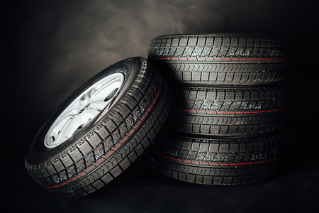 Photo pour studless winter tires, black background - image libre de droit