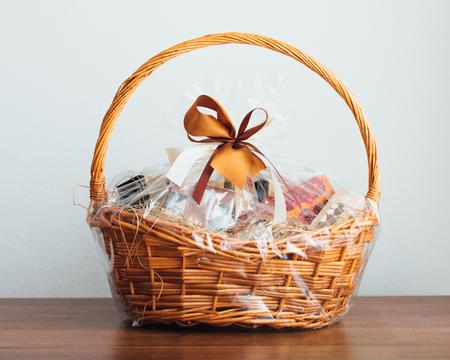 Foto de gift basket on grey background - Imagen libre de derechos