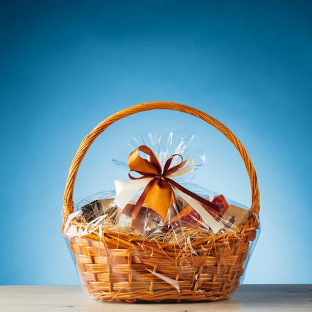 Photo for gift basket on blue background - Royalty Free Image
