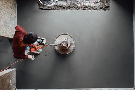 Foto de concrete floor final grinding, top view - Imagen libre de derechos
