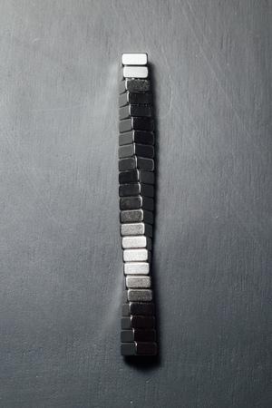 Foto de neodymium magnets spiral, black background - Imagen libre de derechos