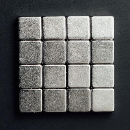 Foto de neodymium magnets squares, black background - Imagen libre de derechos