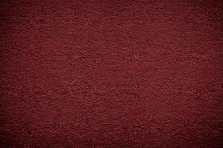 Photo pour Texture of old dark red paper background, closeup. Structure of dense maroon cardboard. - image libre de droit