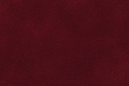Photo for Background of dark red suede fabric closeup. Velvet matt texture of wine nubuck textile. - Royalty Free Image