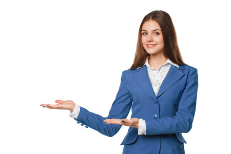Photo pour Smiling woman showing open hand palm with copy space for product or text. Business woman in blue suit, isolated over white background - image libre de droit