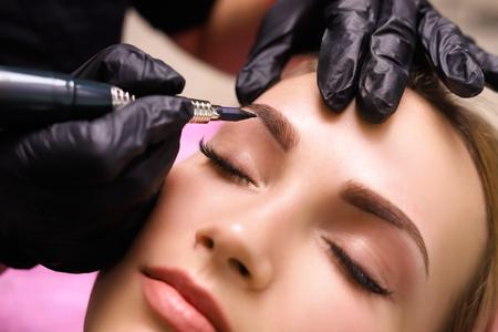 Foto de Permanent make up on eyebrows. - Imagen libre de derechos