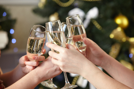 Photo for Glasses of champagne in female hands on Christmas party - Royalty Free Image