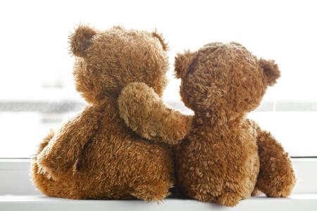 Photo pour Two teddy bears sitting back - image libre de droit