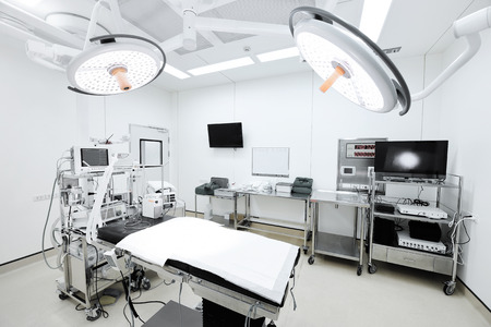 Foto de equipment and medical devices in modern operating room take with selective color technique and art lighting - Imagen libre de derechos