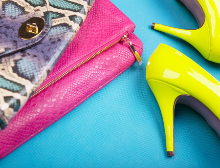 Photo for Neon high heels, and snakeskin print bag, woman fashion concept - Royalty Free Image