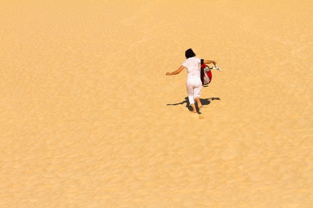 Woman running down the dune