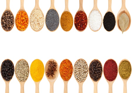 Collection of 18 spices on a wooden spoon  isolated on a white background