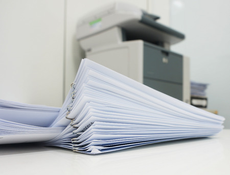 Photo pour The document has been printed, be set and arranged as pile in front of the copier at office. - image libre de droit