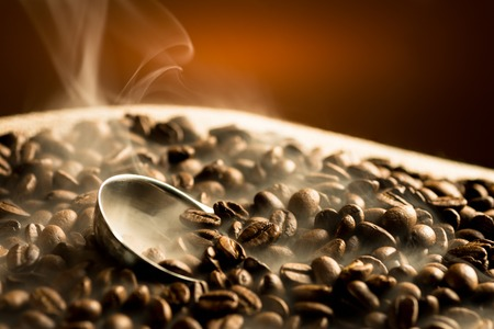 Foto für Roasting coffee beans with smoke on dark background - Lizenzfreies Bild