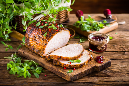 Photo for Roasted pork loin with cranberry and marjoram - Royalty Free Image