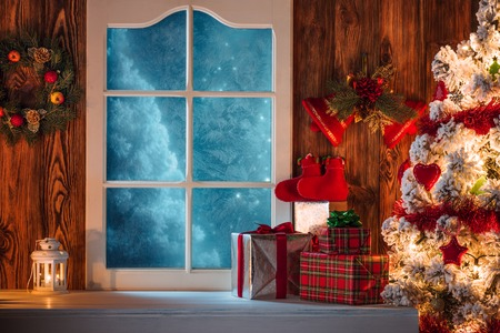 Photo for Christmas scene with tree gifts and frozen window in background - Royalty Free Image