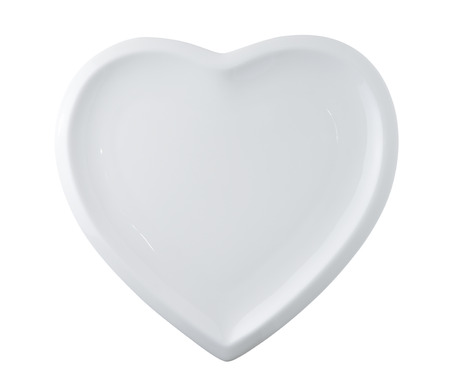 Foto de white plate in shape of heart isolated on white - Imagen libre de derechos
