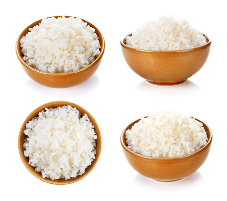 Foto de Rice in a bowl on a white background - Imagen libre de derechos