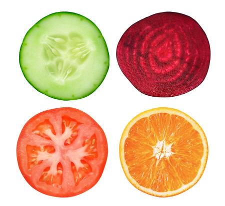 Photo pour slice cucumber,tomato,orange and beetroot on white - image libre de droit