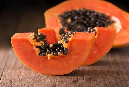 Photo for papaya fruit on wooden board - Royalty Free Image