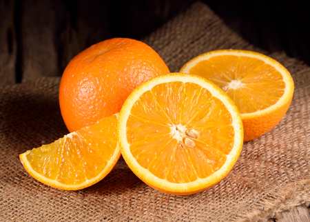 Photo for ripe oranges on wooden table - Royalty Free Image