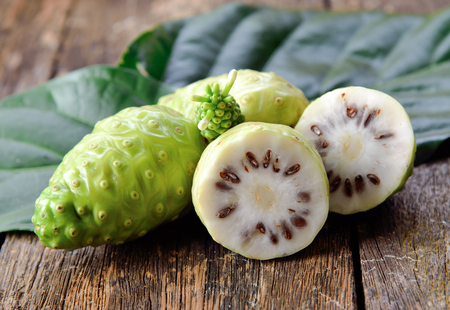 Photo for noni fruit on wooden background - Royalty Free Image