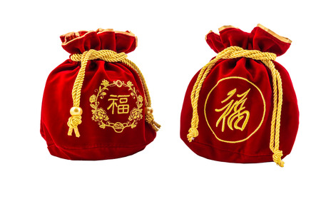 Photo for Chinese New Year Red fabric or silk  bag, ang pow of Traditional chinese isolated on white background with clippingpath - Royalty Free Image
