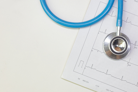 Photo for A Blue stethoscopes and  Electrocardiography  chart close up image. - Royalty Free Image