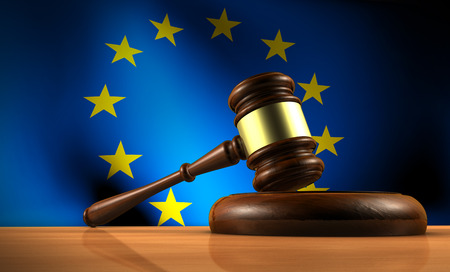 Photo for European Union law, legislation and parliament concept with a 3d rendering of a gavel on a wooden desktop and the EU flag on background. - Royalty Free Image